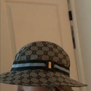 Gucci grey hat with blue and black band